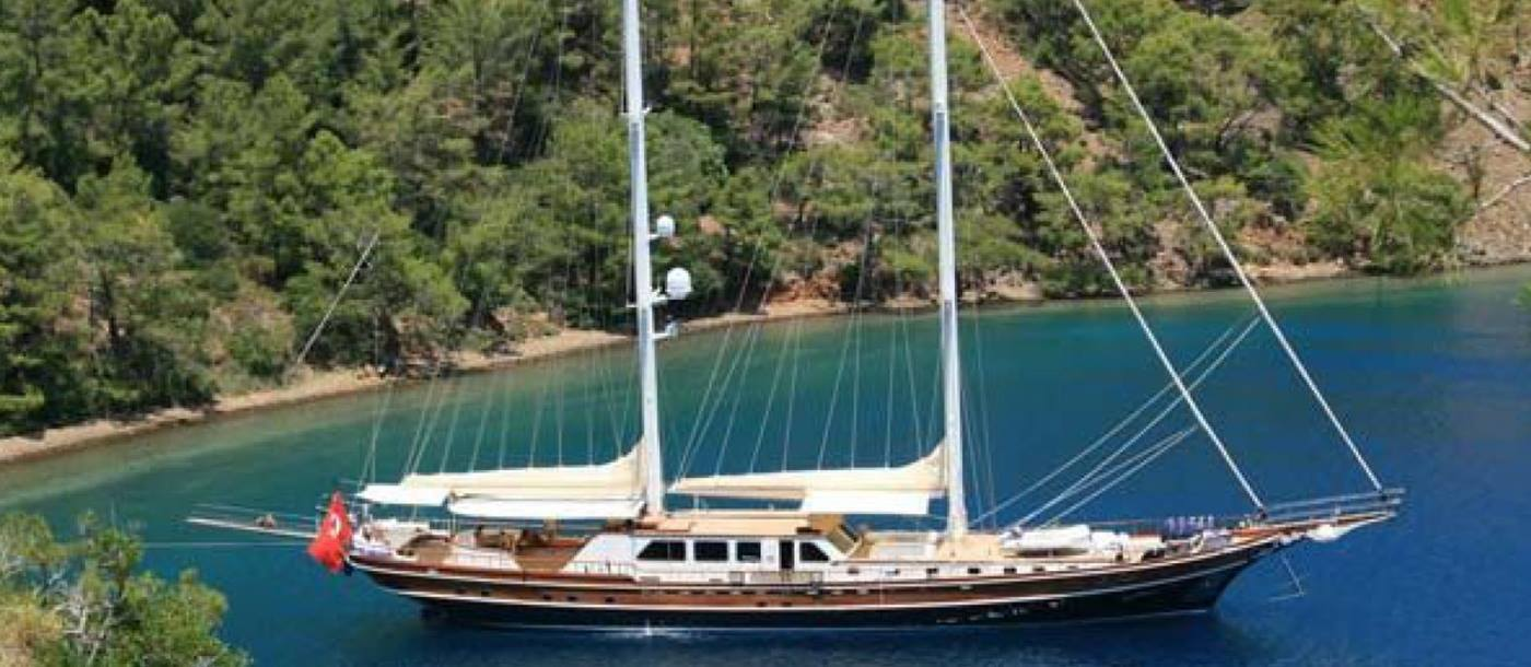 Exterior view of luxury gulet Kaya Guneri IV in a bay